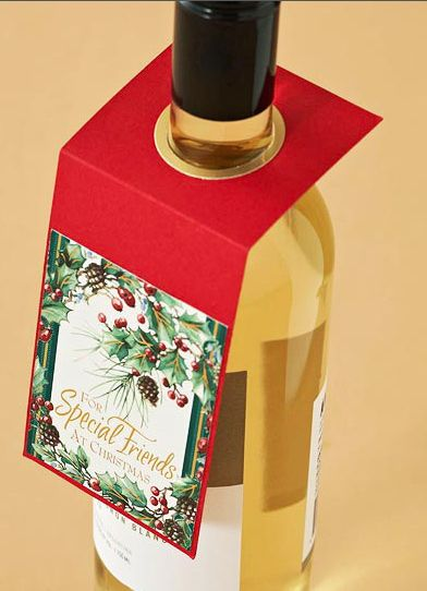 Re-purposed christmas card gift tag on a wine bottle