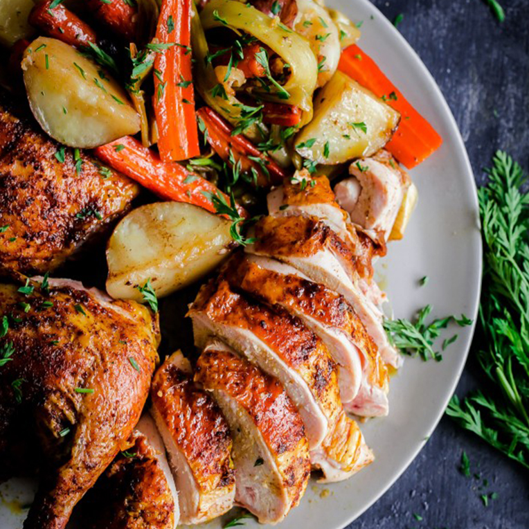 A white plate of Middle Eastern Roast Chicken and vegetables